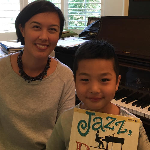 Student with piano teacher